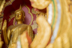 Golden Buddha statue in temple Stock Photography