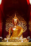 Golden buddha. Statue in thai style on red background Stock Image