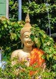 Golden buddha statue in Thai temple Stock Photos