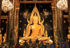 Golden buddha statue. In thailand. generally in Thailand any kind of art decoreted in church or temple area etc. created with donated by people to hire artist royalty free stock image