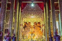 The golden Buddha statue of Thailand temple named `Wat Den Salee Sri Muang Gan Wat Ban Den`. royalty free stock images