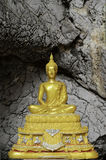 Golden buddha statue at Tham Pu Wa temple Kanchanaburi, Thail Stock Photography