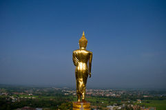 Golden buddha statue. Under the blue sky in Thailand Stock Photos