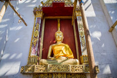 Golden Buddha Statue in under construction temple at Wat Somdej. Sangkhlaburi, Kanchanaburi.Thailand stock photography