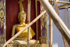 Golden Buddha Statue in under construction temple at Wat Somdej Stock Images