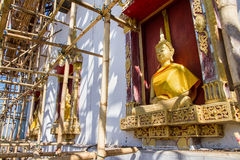Golden Buddha Statue in under construction temple at Wat Somdej. Sangkhlaburi, Kanchanaburi.Thailand royalty free stock images