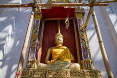 Golden Buddha Statue in under construction temple at Wat Somdej. Sangkhlaburi, Kanchanaburi.Thailand stock photos