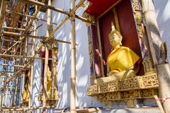 Golden Buddha Statue in under construction temple at Wat Somdej. Sangkhlaburi, Kanchanaburi.Thailand royalty free stock photos