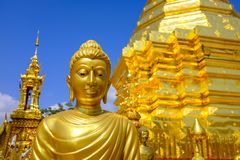Golden Buddha statue at a temple. Golden Buddha statue at the Wat Phra Doi Suthep  Buddhist temple in Chiang Mai, Thailand Royalty Free Stock Photo