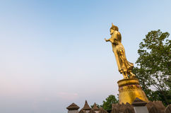 Golden Buddha statue in Wat Phra That Khao Noi, Nan Province, Stock Photography