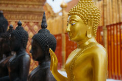 Golden buddha statue in Wat Phrathat temple on Doi Suthep Royalty Free Stock Photos