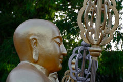 Golden Buddha statues. Along the stairs leading to the Ten Thousand Buddhas Monastery and landscape with green trees in the background in Thailand Stock Photos