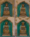 Golden Buddha statues along the wall in the interior of the Linh stock photos
