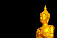 Golden Buddha statues black background Royalty Free Stock Photography