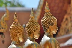 Golden Buddha statues detail. Wat Phra That Doi Suthep temple. Chiang Mai. Thailand. Wat Phra That Doi Suthep is a Theravada Buddhist temple in Chiang Mai Royalty Free Stock Photo