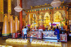 Golden Buddha statues in the interior of the Ten Thousand Buddha Royalty Free Stock Photos