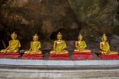 Buddha statues in Khao Luang Cave - Phetchaburi, Thailand. The golden Buddha statues in Khao Luang Cave - Phetchaburi, Thailand stock images