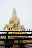 The golden Buddha statues in the mist Royalty Free Stock Image