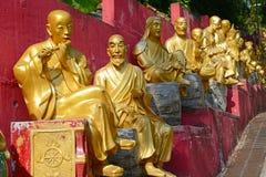 Golden Buddha statues at Ten Thousand Buddhas Monastery, Hong Kong royalty free stock photography