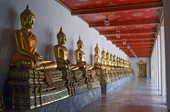 Golden Buddha statues in Wat Pho. Bangkok, Thailand stock photo