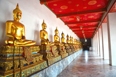 Golden Buddha Statues in Wat Pho Stock Images