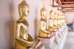 Golden of Buddha statues at Wat Thai Temple worship. By sitting concentrate. it`s faith of buddhism to pray for god helpful and goodluck in Thailand Stock Photo