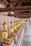 Golden of Buddha statues at Wat Thai Temple worship. By sitting concentrate. it`s faith of buddhism to pray for god helpful and goodluck in Thailand Royalty Free Stock Photography