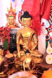 Golden Buddha statuette Stock Photo