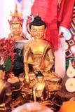 Golden Buddha statuette Stock Photo