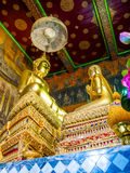 Golden buddha statute and Chief disciple statute. Golden buddha statute and his Chief disciple statute Royalty Free Stock Image