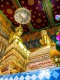 Golden buddha statute and Chief disciple statute. Royalty Free Stock Image