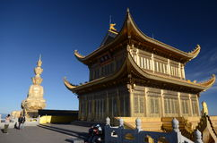 The golden buddha on summit of Emeishan Royalty Free Stock Photo