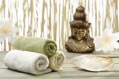 Golden Buddha, towels Royalty Free Stock Photo
