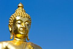 Golden Buddha under the open sky Stock Images