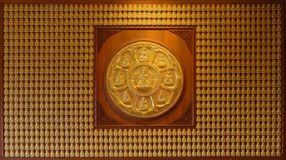 Golden Buddha wall Royalty Free Stock Photo