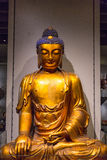 Golden Buddha by Wall Royalty Free Stock Photography