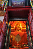 Golden Buddha at The Wat Phanan Choeng Stock Photo