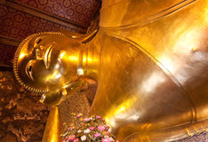 Golden buddha in Wat Pho Stock Photo