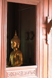 Golden Buddha & window Royalty Free Stock Photography