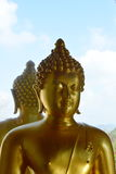 Golden Buddha on the window Royalty Free Stock Photos