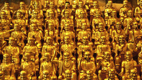 Golden Buddhas. Part of a collection of 500 little Buddhas in the longhua temple, Shanghai, China. The figures symbolize the helper or students of Buddha Stock Image