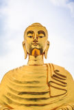 Golden Buddhas image. Located in a Thai temple Stock Photo