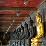 Golden Buddhas In Wat Sutat, Bangkok Royalty Free Stock Photo