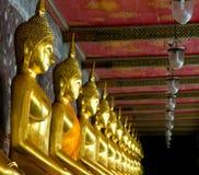 Golden Buddhas In Wat Sutat, Bangkok Royalty Free Stock Images