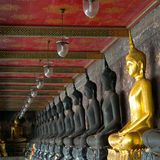 Golden buddhas in wat sutat, bangkok Royalty Free Stock Photo