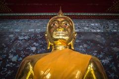 Golden buddhas in Wat Suthat, Bangkok Stock Photography