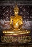 Golden buddhas in Wat Suthat, Bangkok Royalty Free Stock Image