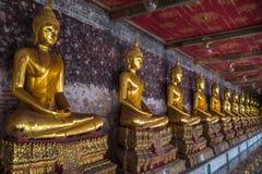 Golden buddhas in Wat Suthat, Bangkok Royalty Free Stock Photos