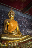 Golden buddhas in Wat Suthat, Bangkok Stock Photo