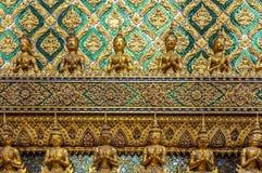 Golden Buddhas and Yakshas Stock Photo